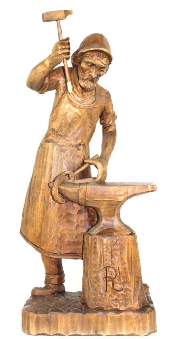 "POSSIBLY GERMAN CARVED WOODEN ""BLACKSMITH"""