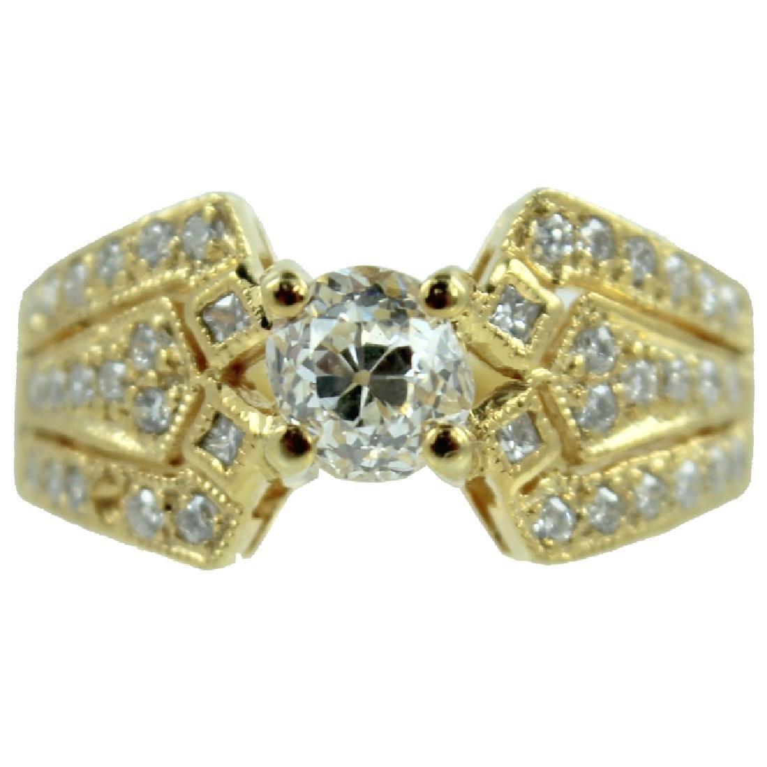 OLD MINE CUT DIAMOND. 0.60 POINTS. 18K
