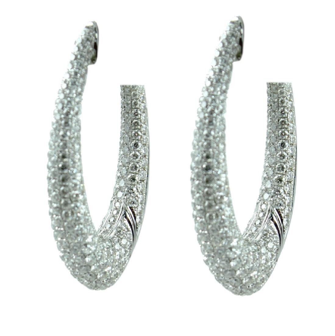 14K Ladies Diamond hoop Earrings.