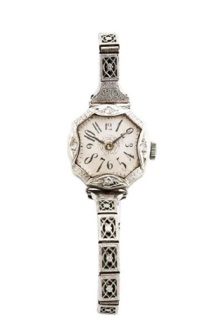 Antique white gold mechanical lady's watch by Buch
