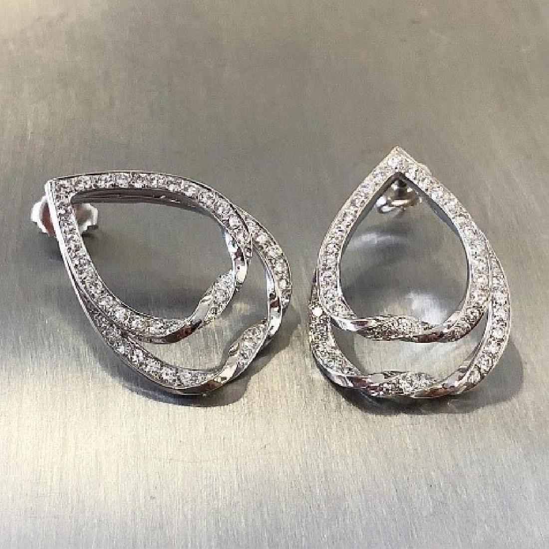 14 karat white gold and diamond earrings. 98 round