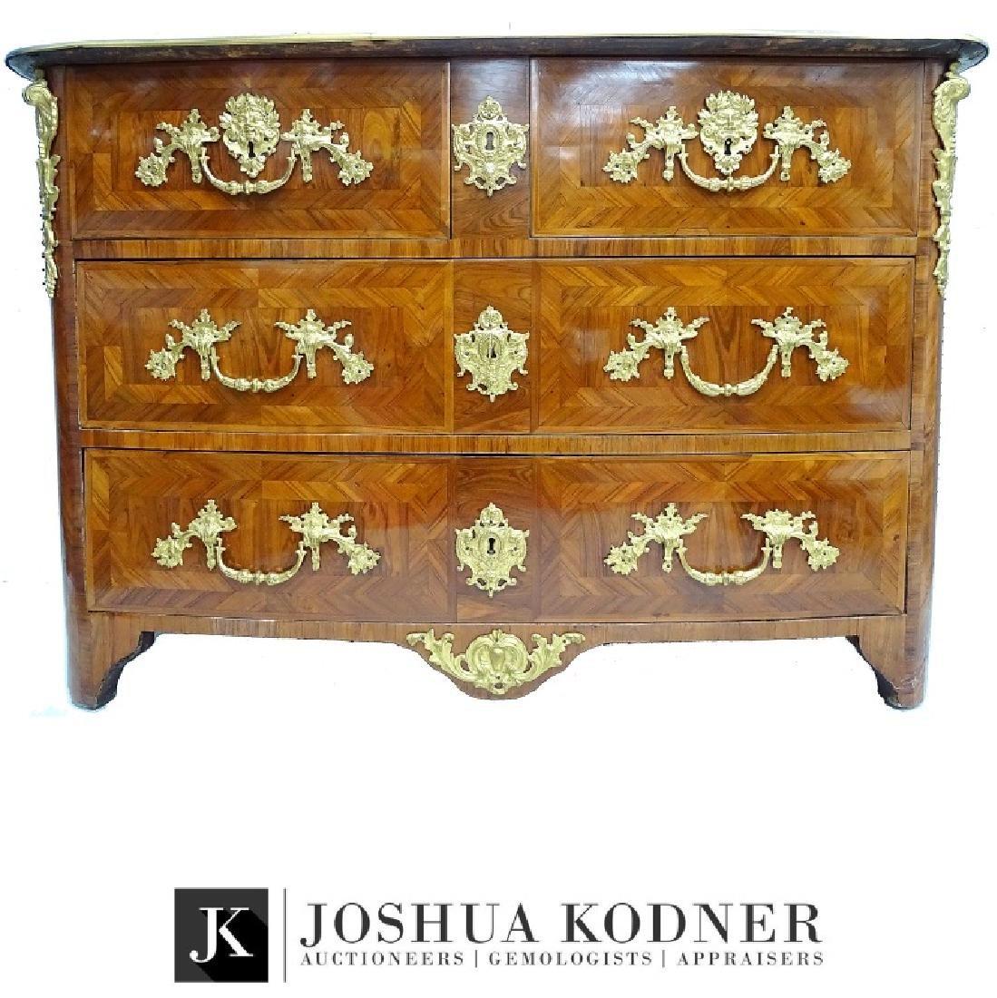 A Régence gilt-bronze mounted kingwood parquetry