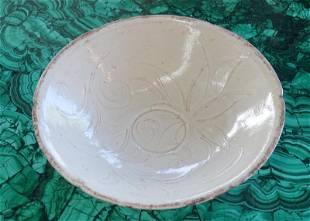 A Chinese White Glazed Molded Flower Bowl