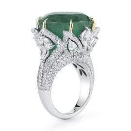 ROUND EMERALD AND DIAMOND RING