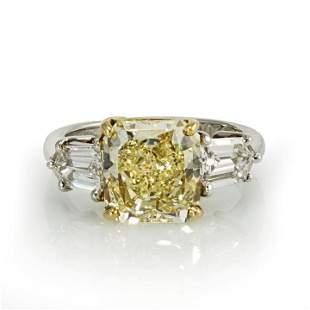 3 CARAT RADIANT CUT DIAMOND FANCY YELLOW GIA RING