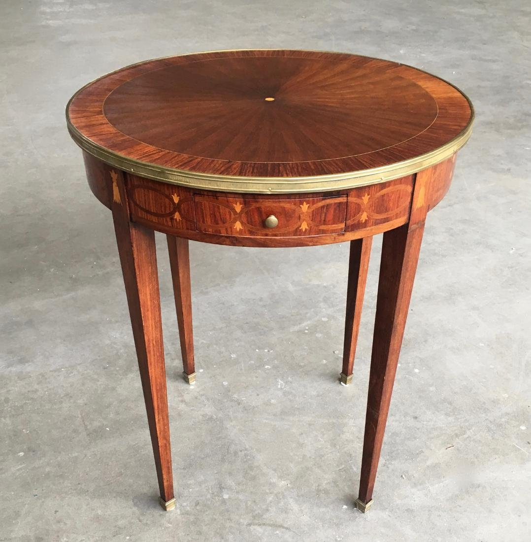 Early century LXVI style round table bouillotte with