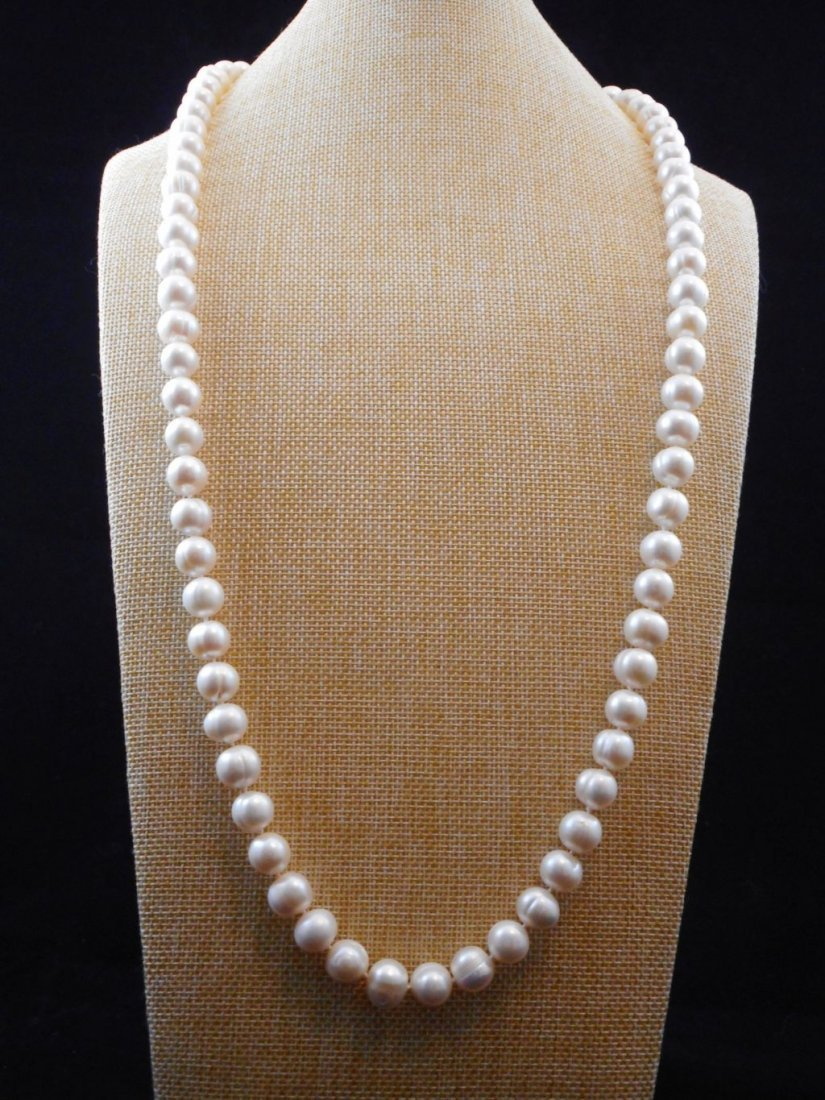 Pearl necklace of white baroque cultivated  pearls