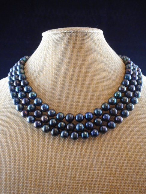 Triple strand necklace of cultured freshwater pearls