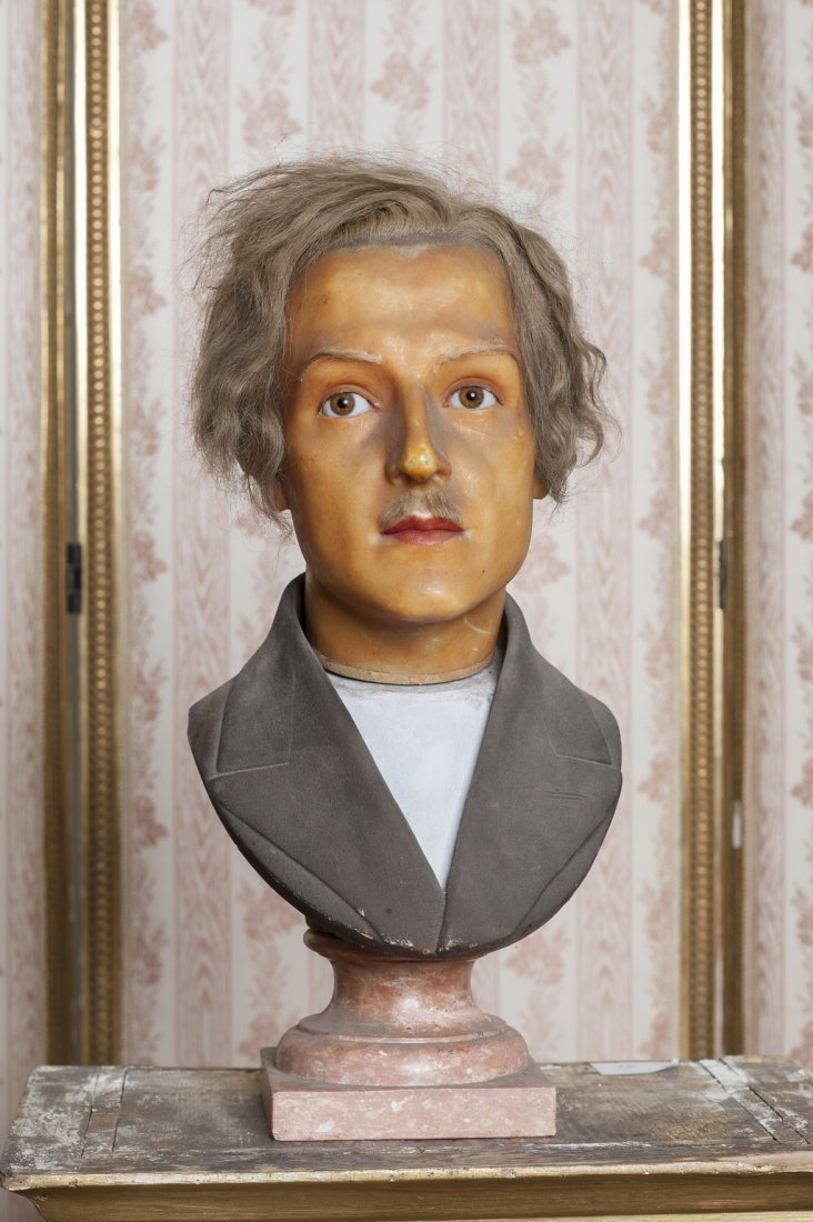 Wax mannequin head on marble stand