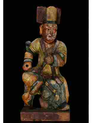 A WOODEN CARVED FIGURE