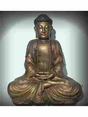 A WOODEN FIGURE OF SHAKYAMUNI