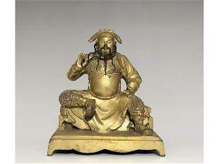A GILT-BRONZE FIGURE OF GUAN GONG