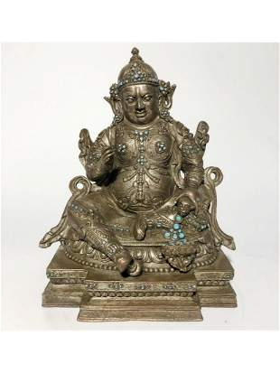 A SILVER-BRONZE FIGURE OF JAMBHALA