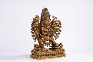 A Sino Tibetan Gilt Bronze and Inlaid Figure of