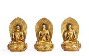 A Rare Set of Three Mongolian Gilt Bronze Buddha
