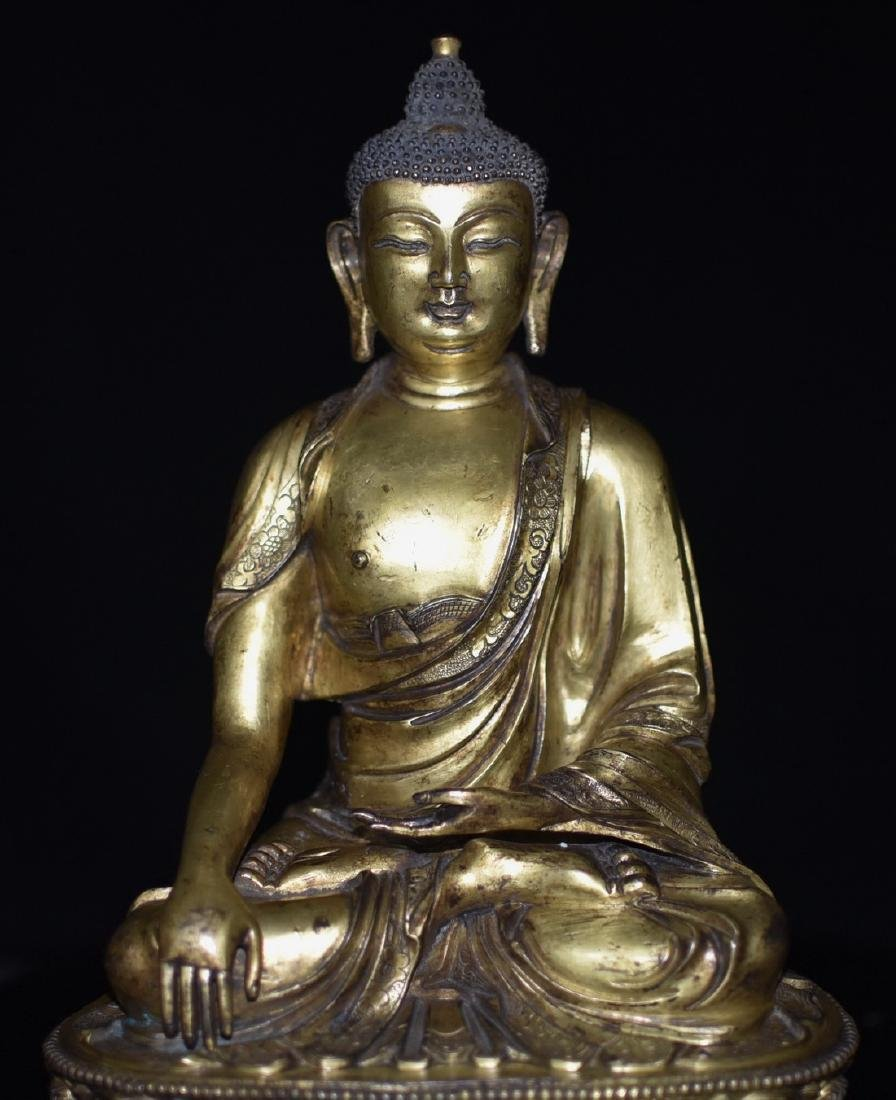 A GILT-BRONZE FIGURE OF BUDDHA AMITABHA