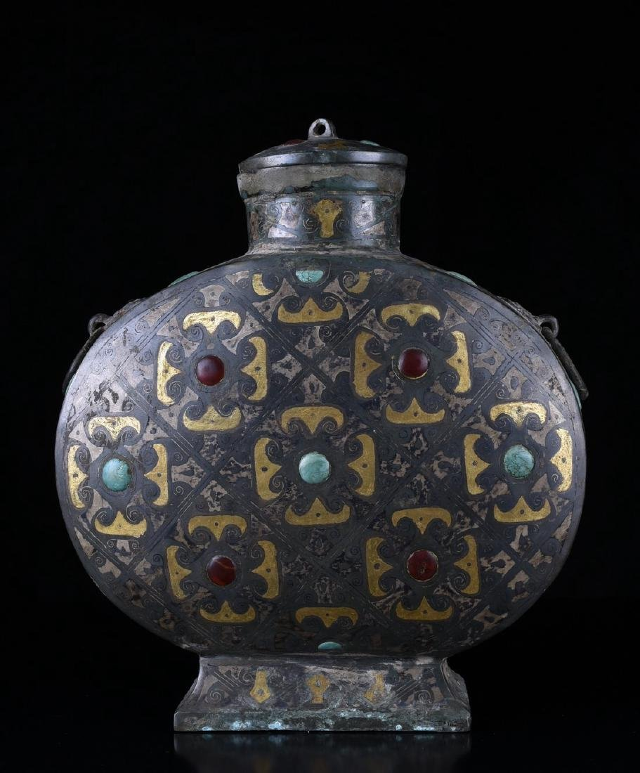 A PARCEL-GILT BOTTLE