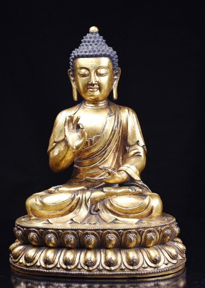 A GILT-BRONZE BUDDHA