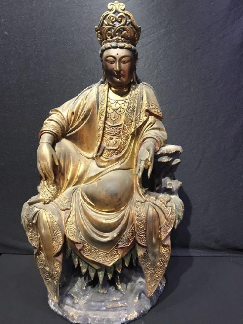A ZHANG WOOD CARVING OF GUANYIN