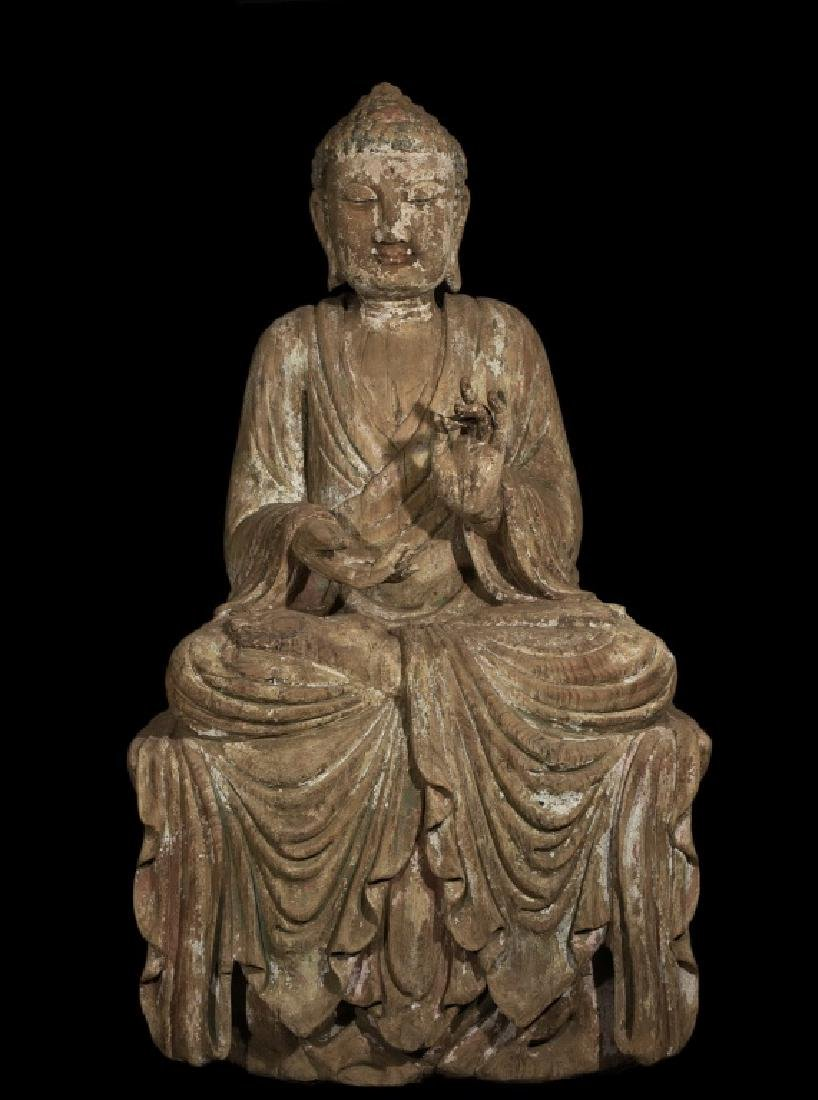 A WOODEN FIGURE OF SEATING BUDDHA