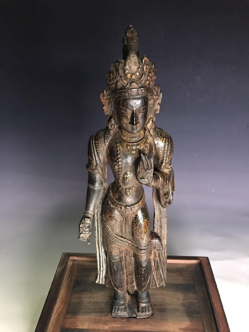 AN ANTIQUE WOODEN FIGURE OF BUDDHA