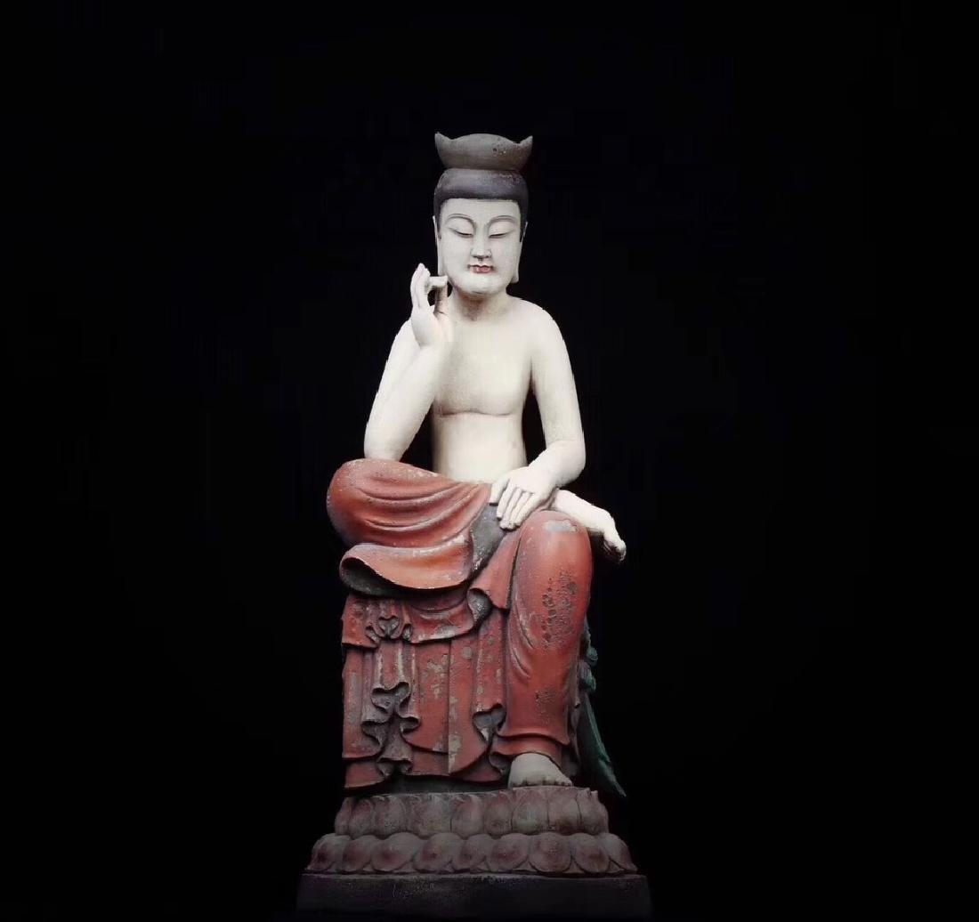 A XIANGZHANG WOOD FIGURE OF BUDDHA