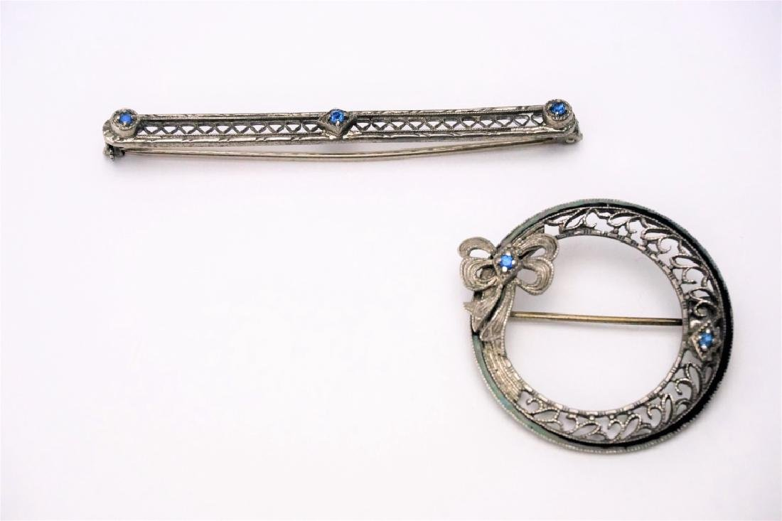 (2) STERLING SILVER PINS WITH BLUE STONES