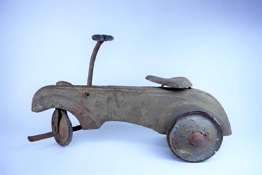 VINTAGE FRICTION POWERED PEDAL CAR
