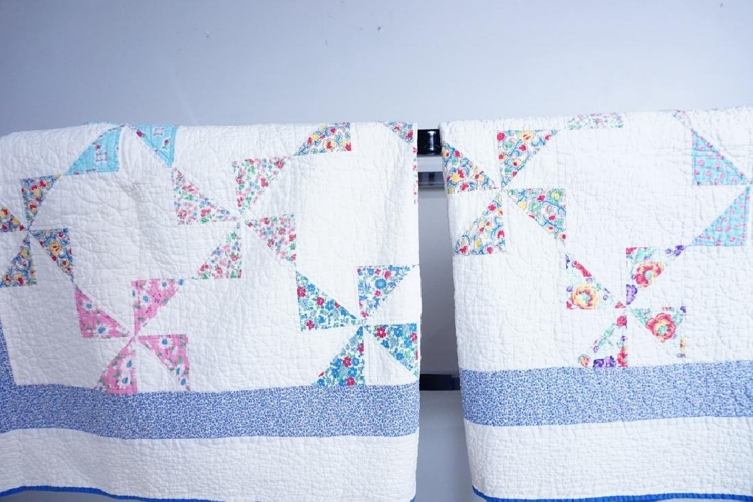 PAIR VINTAGE HAND STITCHED PINWHEEL QUILTS