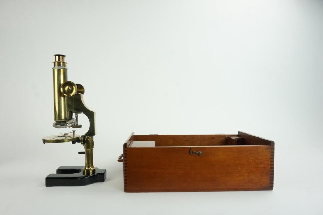 BRASS MICROSCOPE WITH CAST IRON BASE