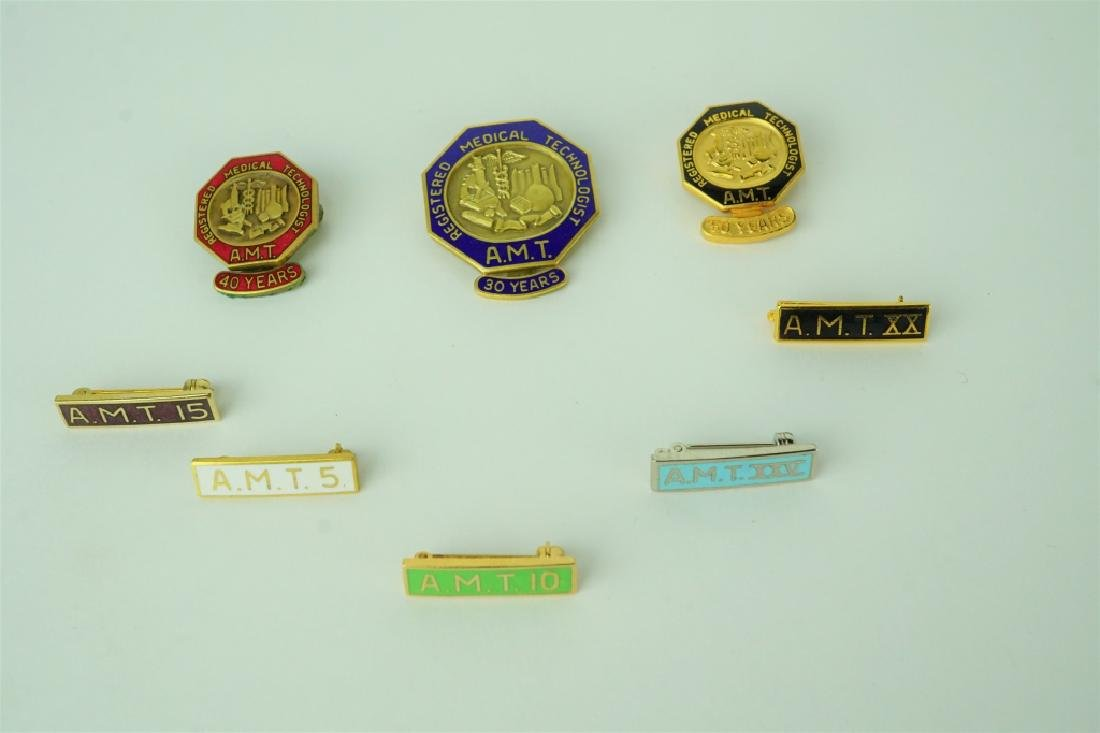 (8) ASSORTED REGISTERED MEDICAL TECHNOLOGIST PINS