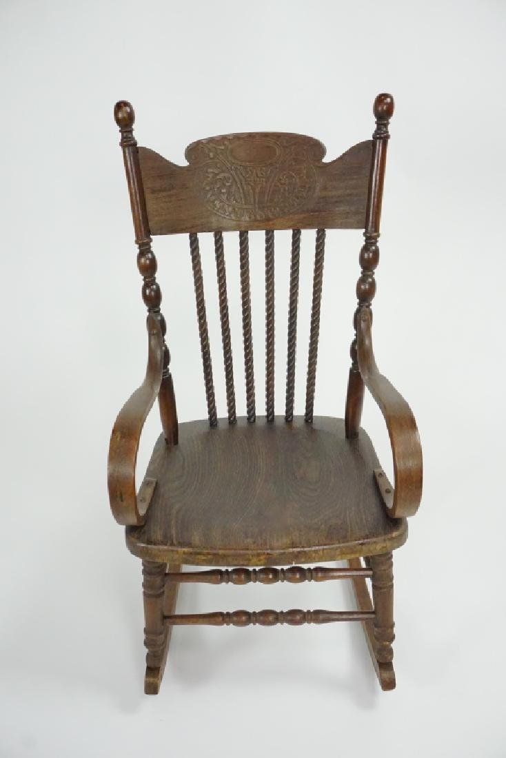 ANTIQUE CHILD'S OAK PRESSED BACK ROCKER