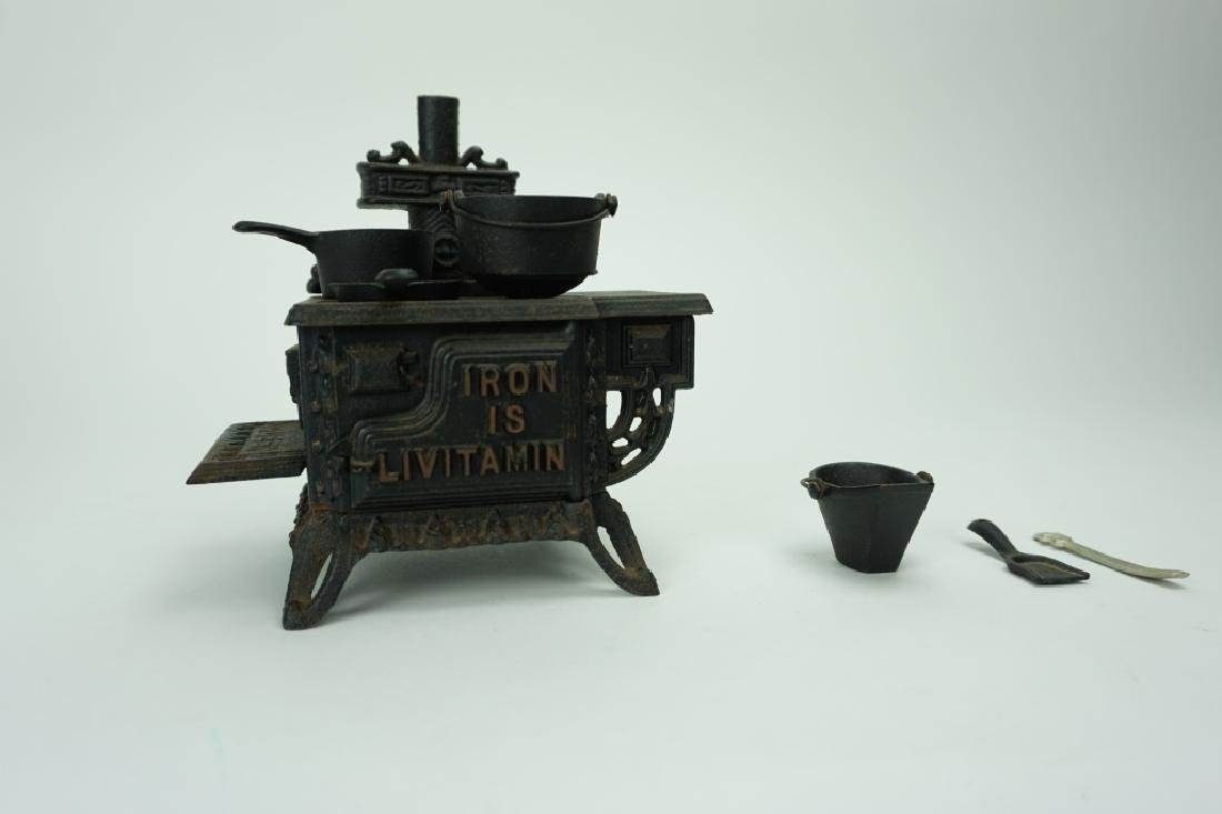 1960'S SALESMAN SAMPLE LIVITAMIN CAST IRON STOVE - 3
