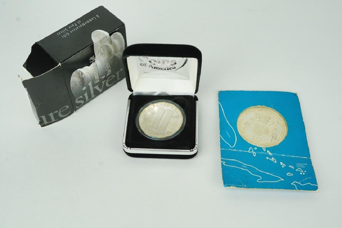 (2) SILVER COMMEMORATIVE COINS