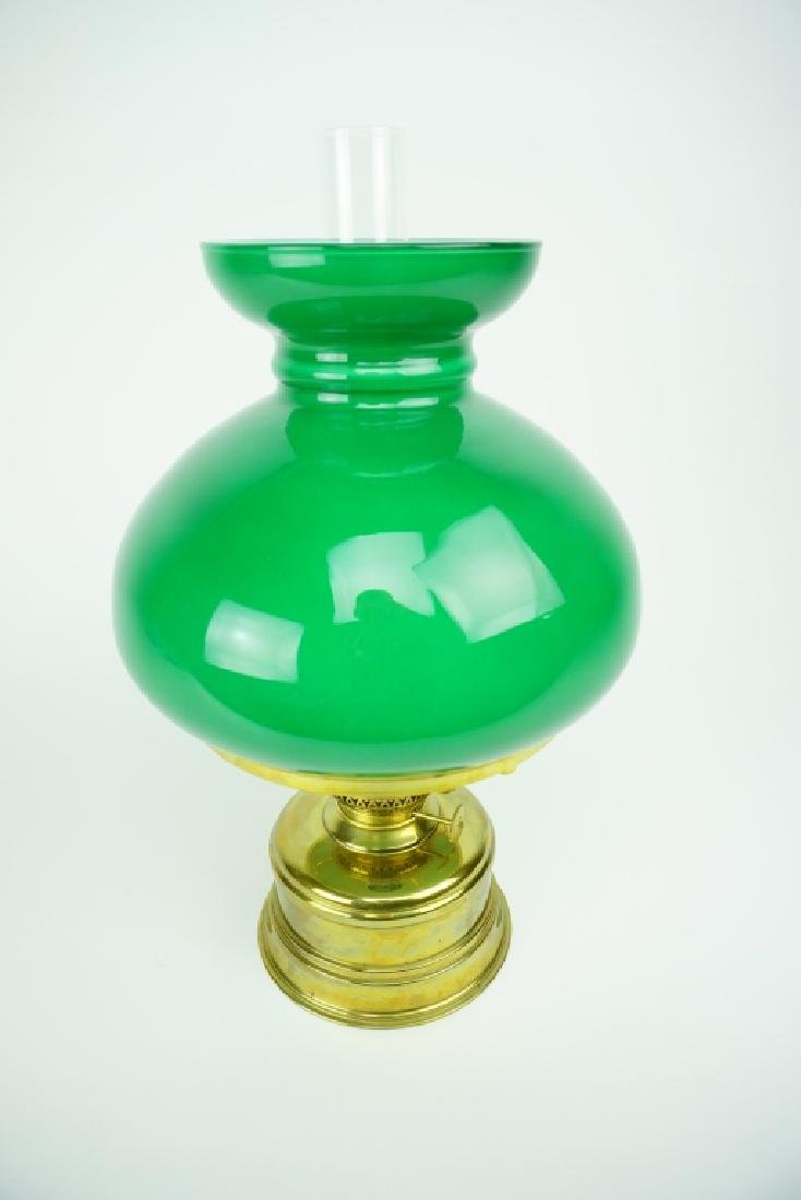 VINTAGE BRASS OIL LAMP WITH GREEN GLOBE