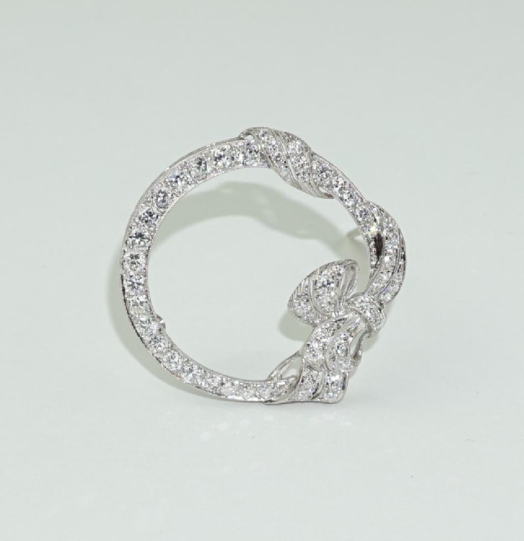 PLATINUM AND DIAMOND CIRCLE RIBBON PIN
