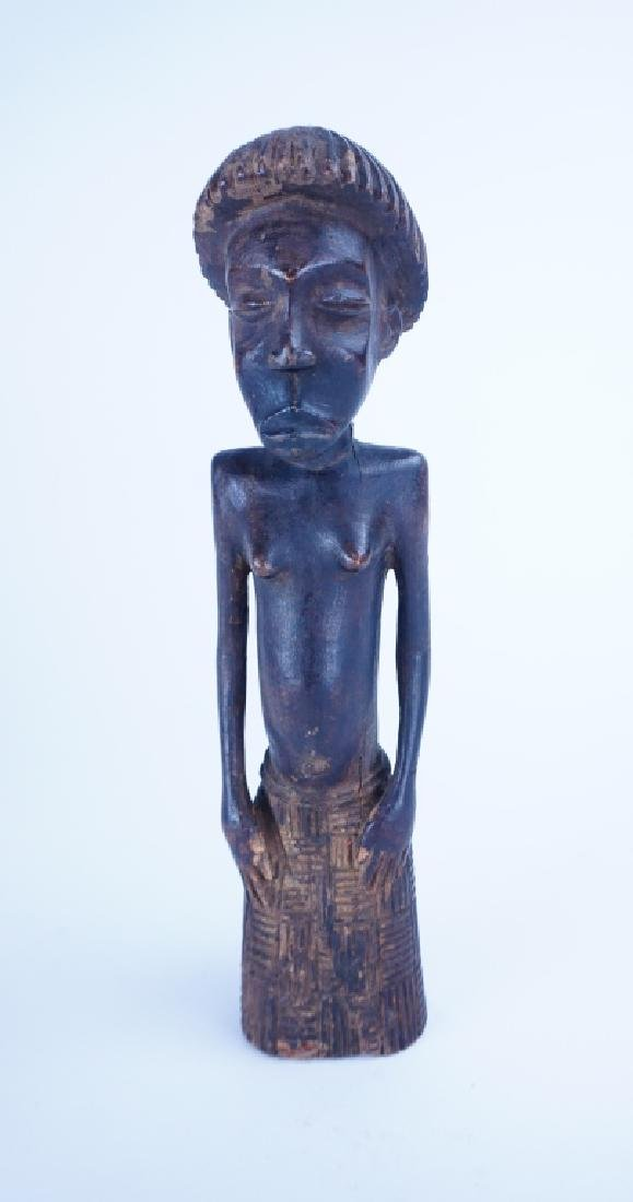 CARVED AFRICAN FIGURE OF WOMAN IN SKIRT