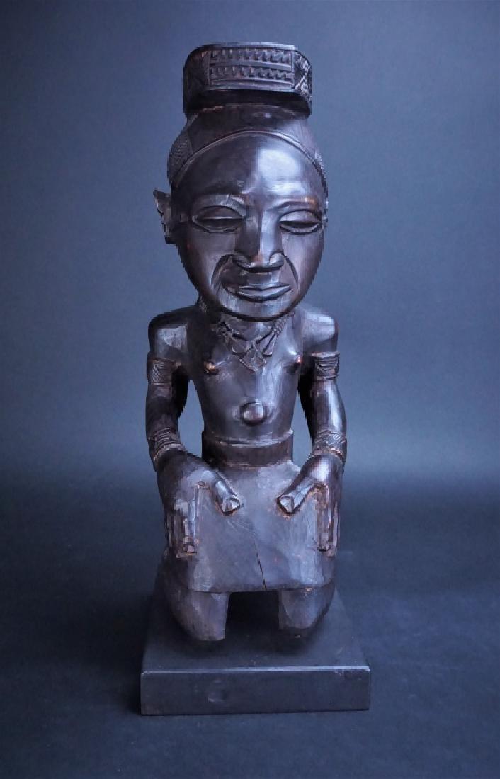 AFRICAN IDOL MOUNTED ON WOOD BASE
