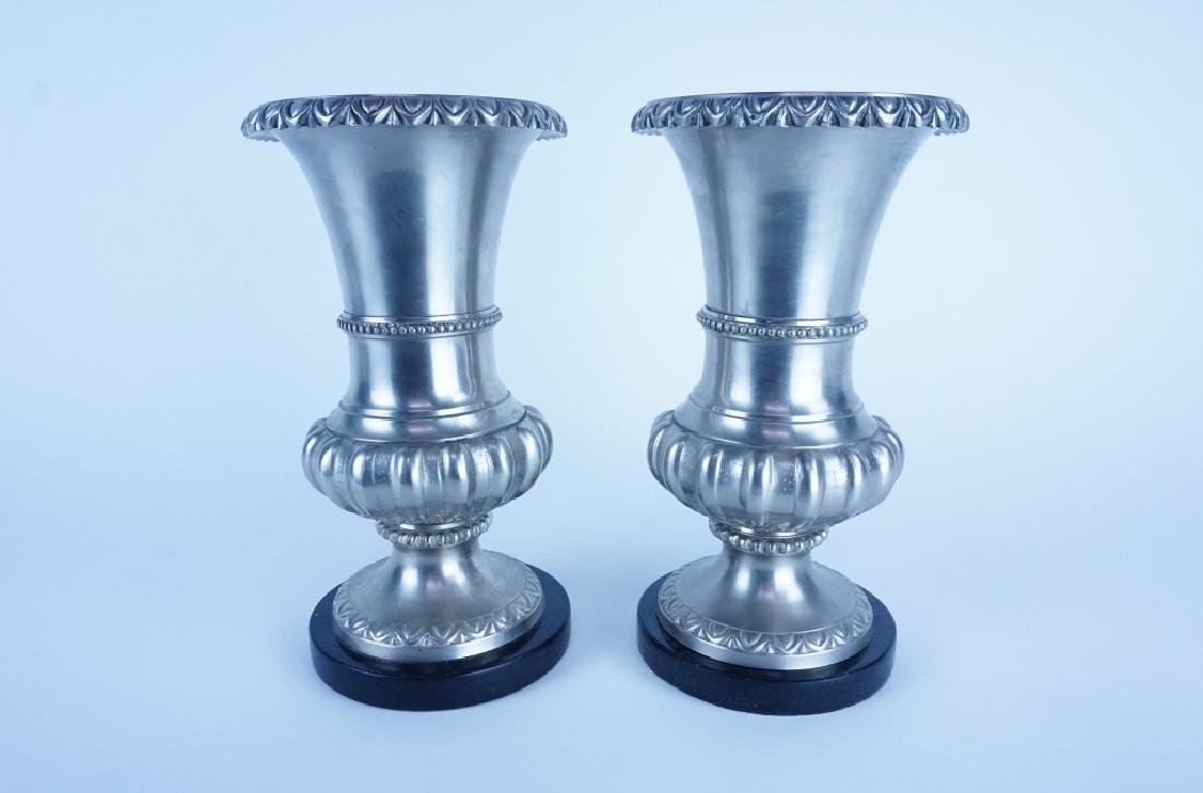 PAIR OF POLISHED CAST MIXED METAL VASES