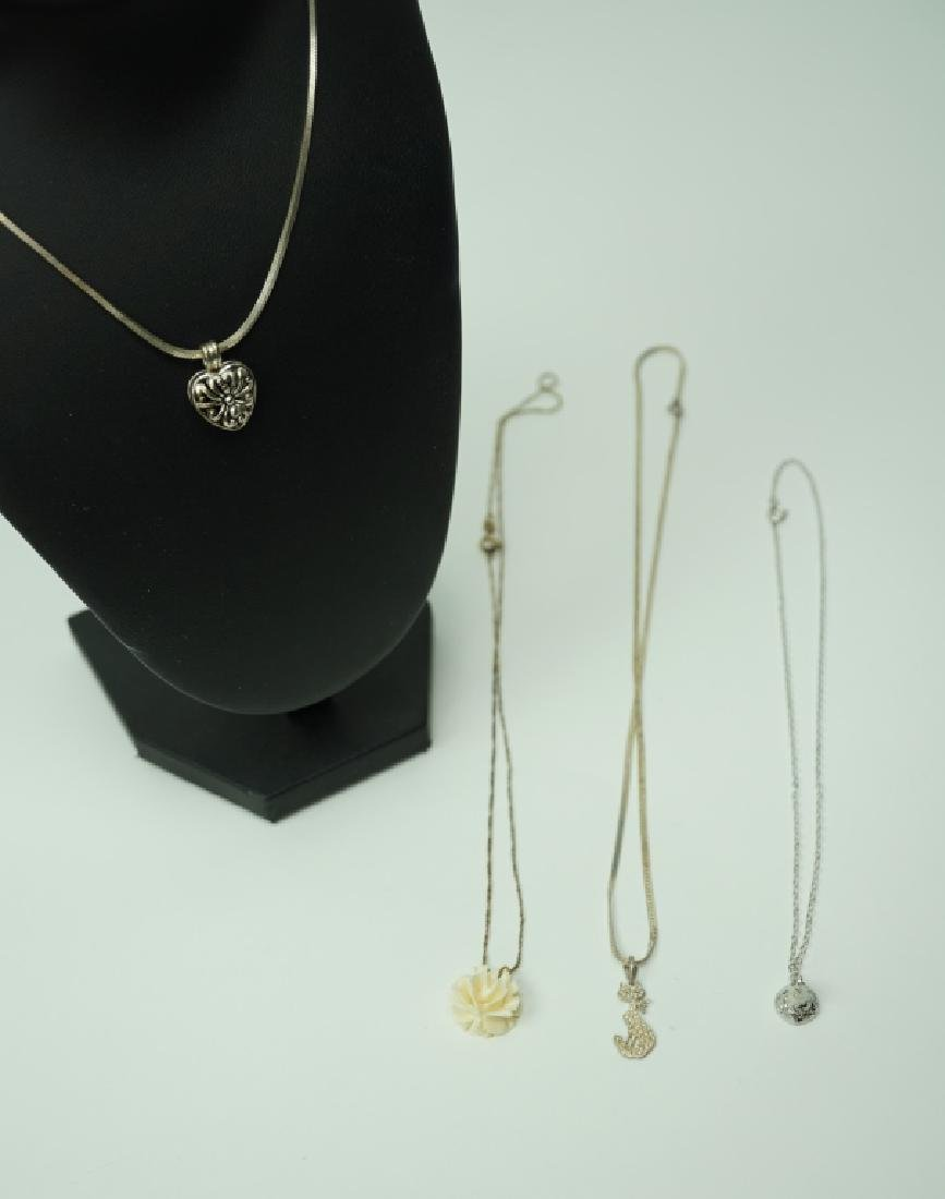 (4) STERLING SILVER CHAINS WITH PENDANTS