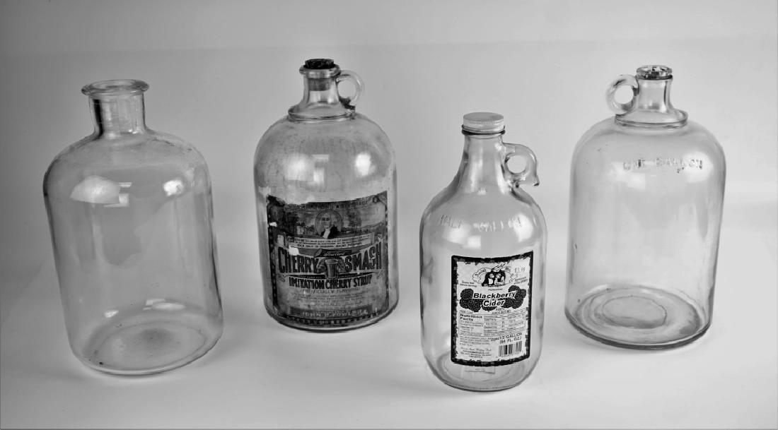 (4) VINTAGE GLASS JUGS - 4
