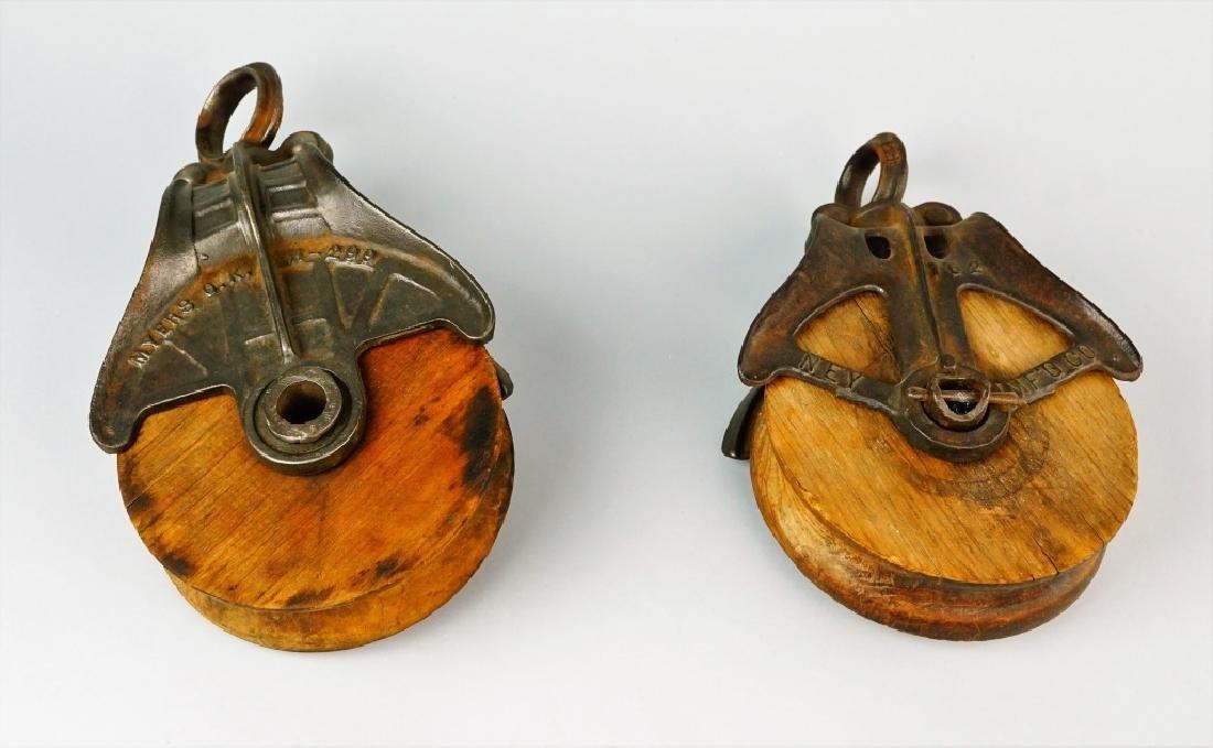 (2) VINTAGE CAST IRON & WOOD PULLEYS