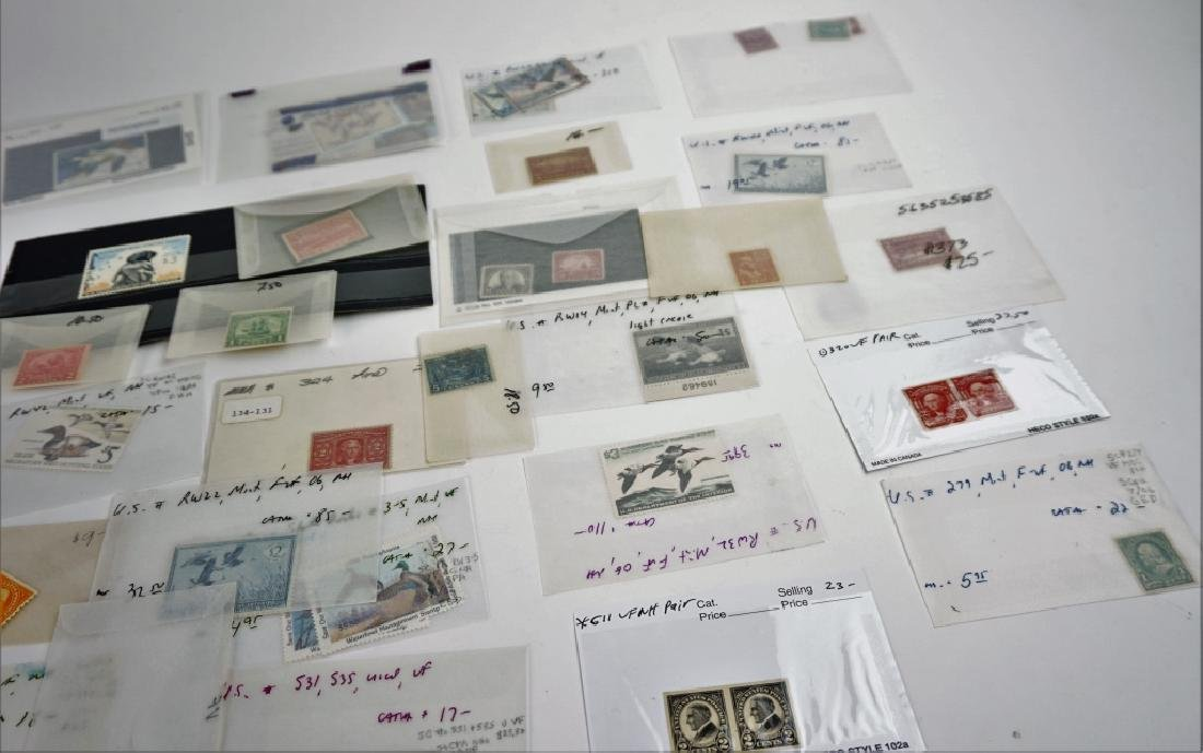 ASSORTED VINTAGE AND ANTIQUE STAMPS - 4