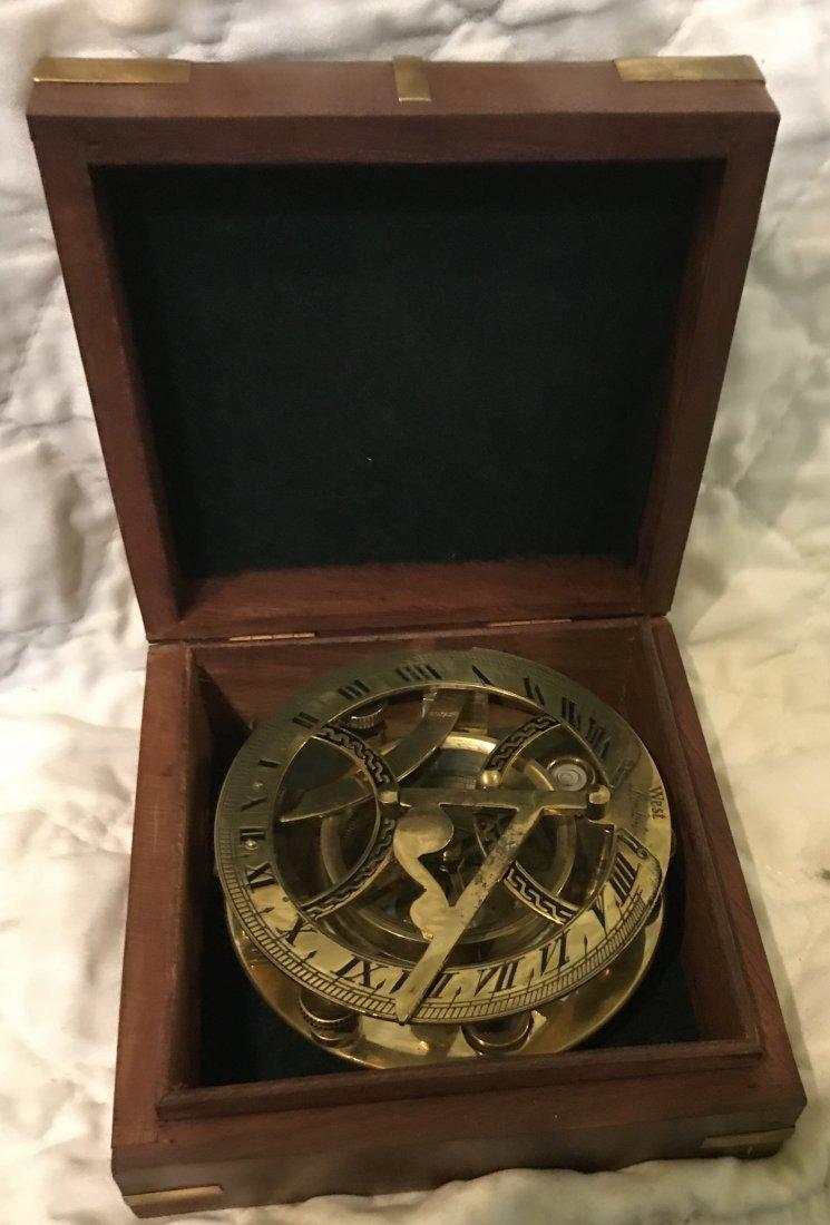 English Nautical brass compass in box.