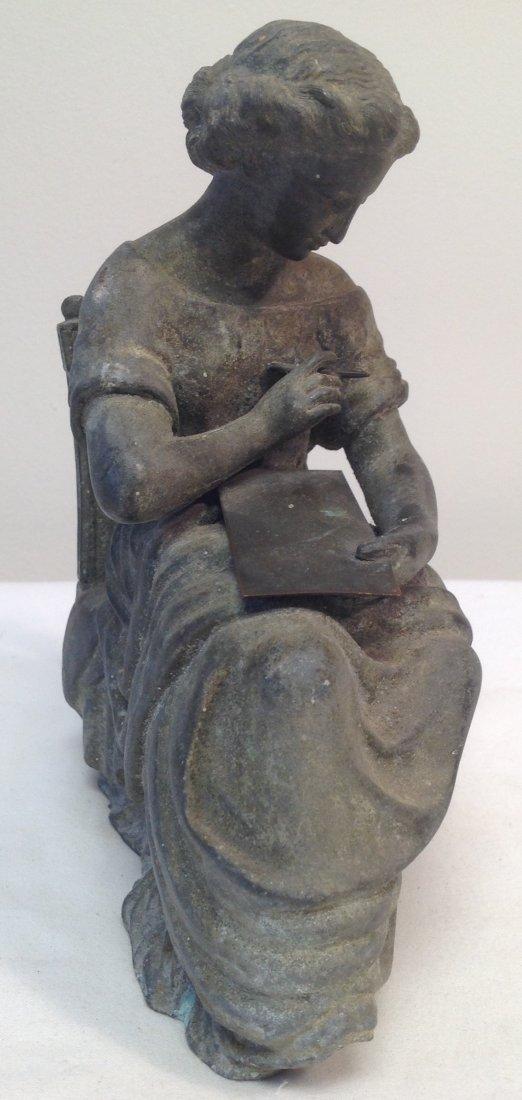 Woman Sitting on Chair Figurine