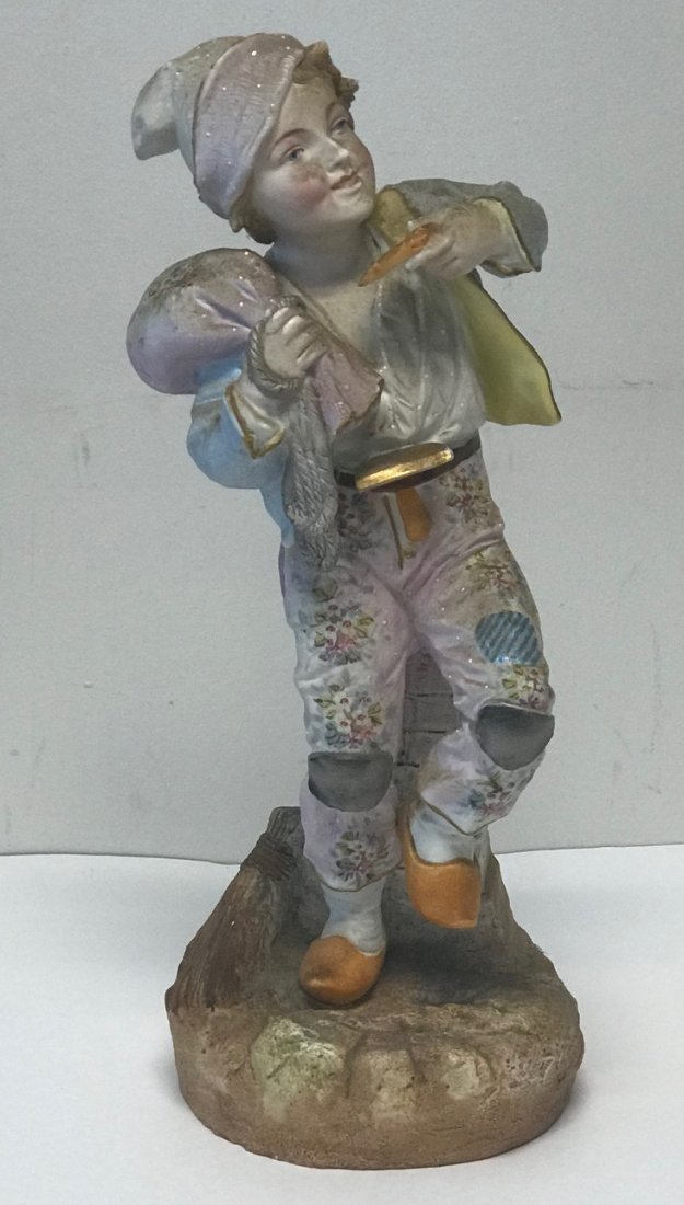 Boy carrying sack figurine 14.5 - 2