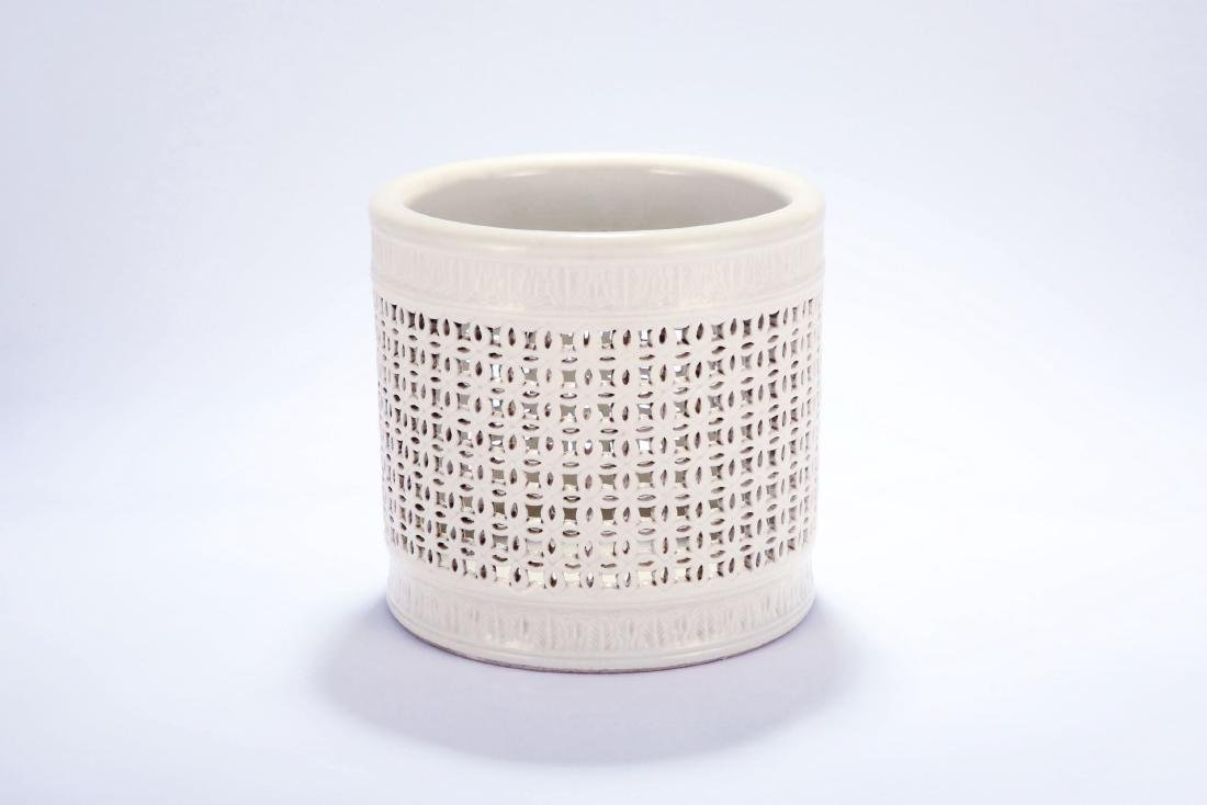 Chinese Blanc de Chine reticulated porcelain brush pot,