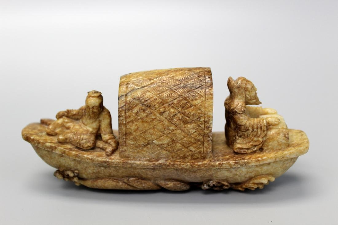 Chinese carved russet jade junk.