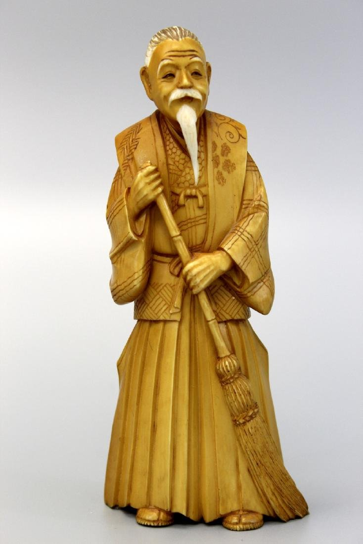 Japanese carving of an old man.