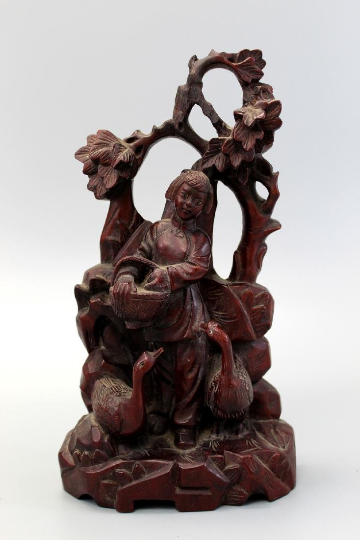 Chinese carved hardwood statue.